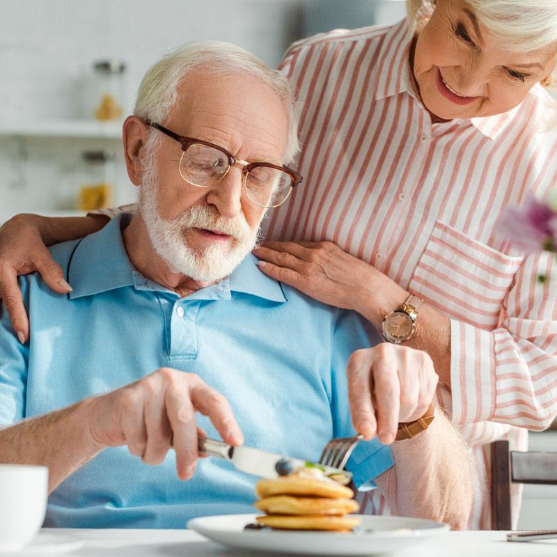 Older man enjoying pancakes