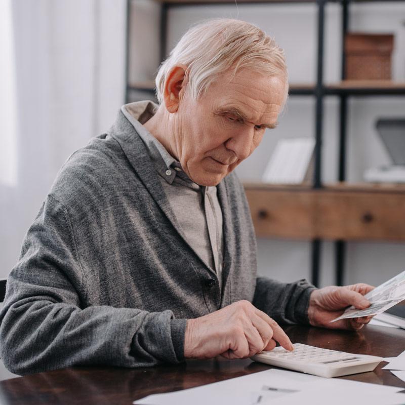 Old man doing paperwork