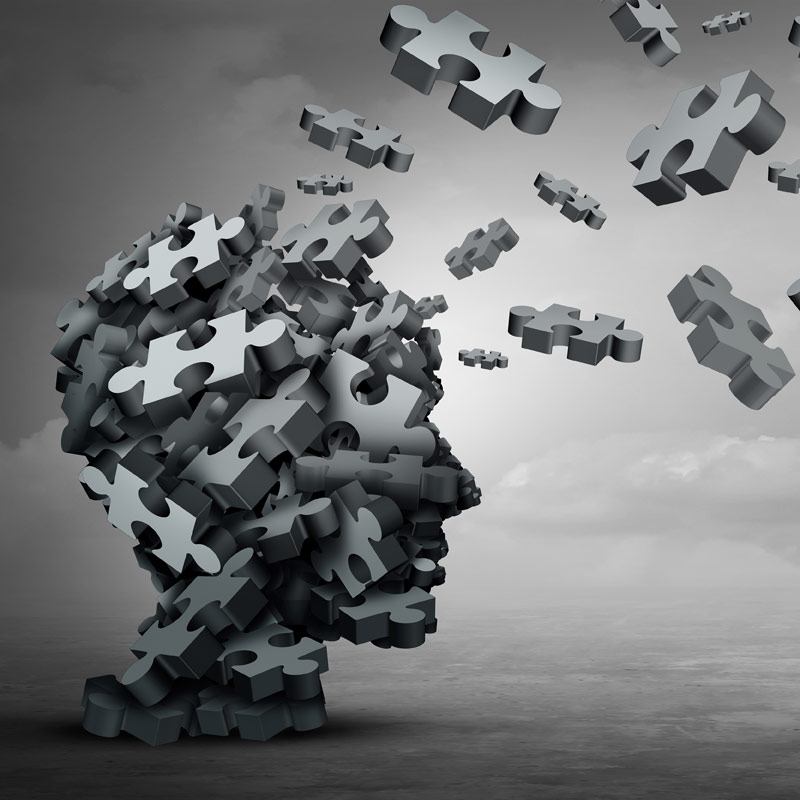 Head made of puzzle pieces breaking off